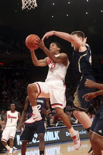 St. John's Jamal Branch (0) goes up against Notre Dame's Jack Cooley during the second half of an NCAA college basketball game, Tuesday, Jan. 15, 2013, at Madison Square Garden in New York. St. John's won 67-63. (AP Photo/Mary Altaffer)