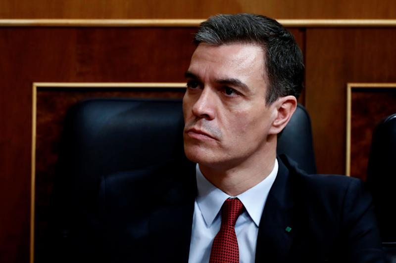 Spanish Prime Minister Pedro Sanchez attends a session at the Lower Chamber in Madrid on March 25, 2020 to debate the extension of a national lockdown until April 11 in an effort to slow down the spread of the COVID-19 coronavirus. - As the global death toll soared past 20,000, Spain joined Italy in seeing its number of fatalities overtake China, where the virus first emerged just three three months ago. (Photo by Mariscal / various sources / AFP) (Photo by MARISCAL/EFE/AFP via Getty Images)