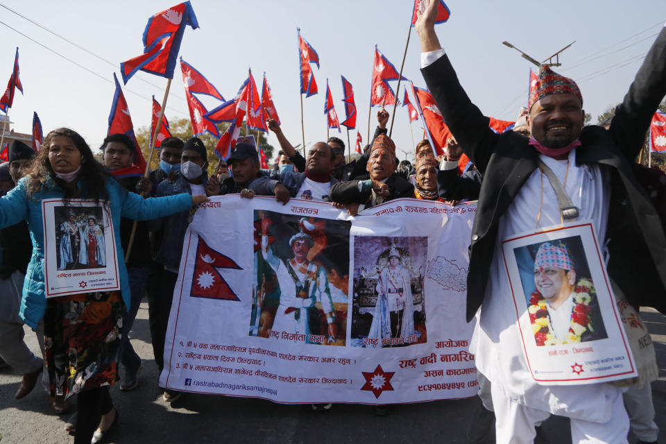 Pro-king supporters march demanding reinstating monarchy that was abolished more than a decade ago in Kathmandu, Nepal, Monday, Jan.11, 2021. Monday's protest was the latest anti-government protest against Prime Minister Khadga Prasad Oli who has been facing street demonstrations against him from a splinter faction of his own Communist party and more from opposition political groups for dissolving parliament. Nepal's centuries-old monarchy was abolished in 2008 by the parliament and replaced by a republic where the president was elected as the head of state. (AP Photo/Niranjan Shrestha)