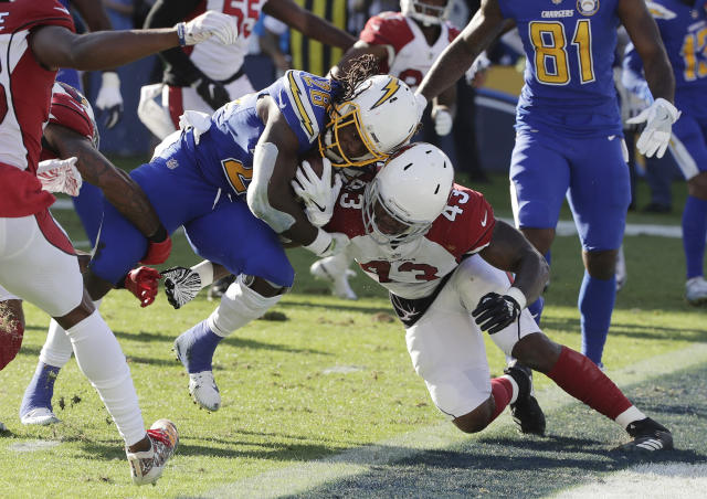 Melvin Gordon scores against the Cardinals on Sunday. (AP)