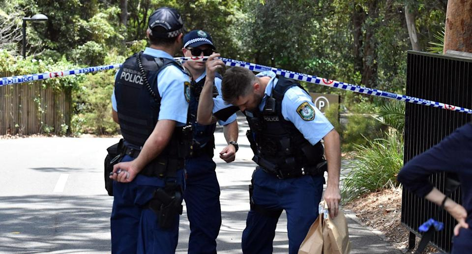 A second Scientology member was injured. NSW Police are pictured here on the scene at Chatswood. Source: AAP