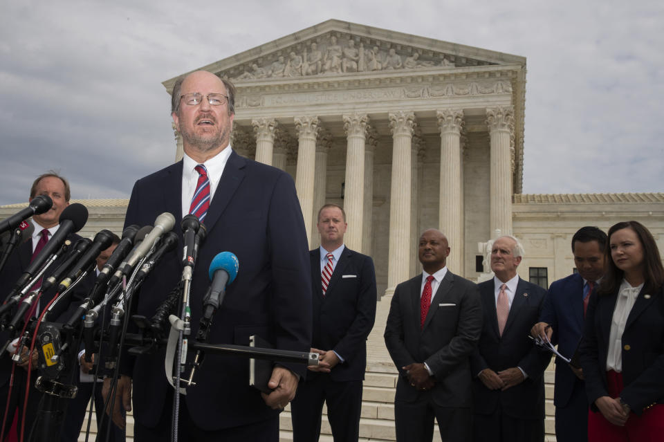 Alaska Attorney General Kevin Clarkson with a bipartisan group of state attorneys general speaks to reporters in front of the U.S. Supreme Court in Washington, Monday, Sept. 9, 2019. A bipartisan coalition of 48 states along with Puerto Rico and the District of Columbia said Monday it is investigating whether Google's search and advertising business is engaged in monopolistic behavior. It follows a Friday announcement of a similar multistate probe targeting Facebook. (AP Photo/Manuel Balce Ceneta)