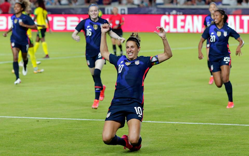 Carli Lloyd - US women footballers get same contracts as men — but equal pay row rumbles on