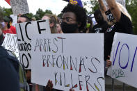 A woman holds up a sign during a rally in memory of Breonna Taylor on the steps of the Kentucky State Capitol in Frankfort, Ky., Thursday, June 25, 2020. The rally was held to demand justice in the death of Taylor who was killed in her apartment by members of the Louisville Metro Police Department on March 13, 2020. (AP Photo/Timothy D. Easley)