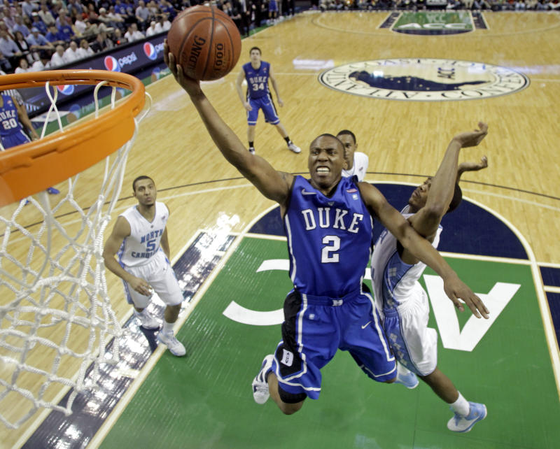 Duke's Nolan Smith (2) goes to the basket against North Carolina in the first half of Duke's 75-58 win in an NCAA college basketball game for the championship of the Atlantic Coast Conference tournament in Greensboro, N.C., Sunday, March 13, 2011. (AP Photo/Bob Leverone)