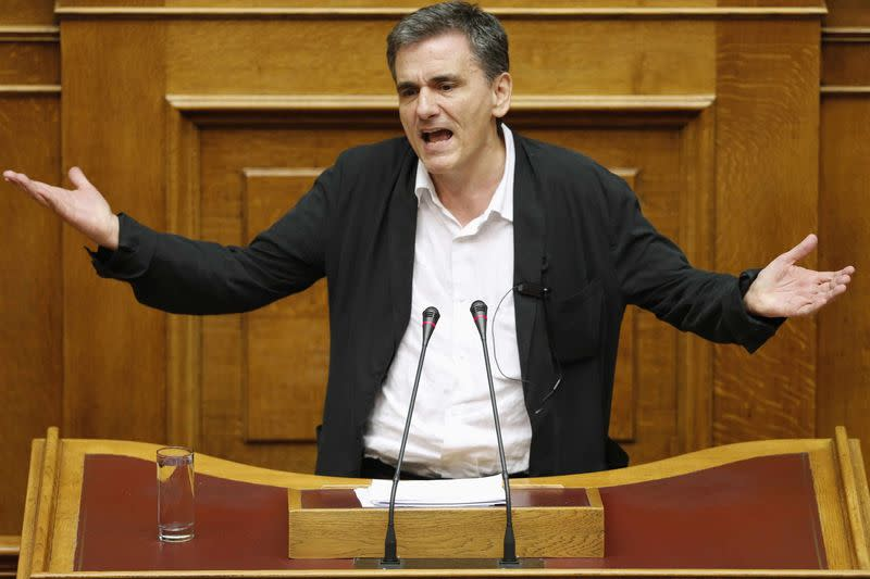 Greek Finance Minister Euclid Tsakalotos delivers his speech during a night parliamentary session in Athens