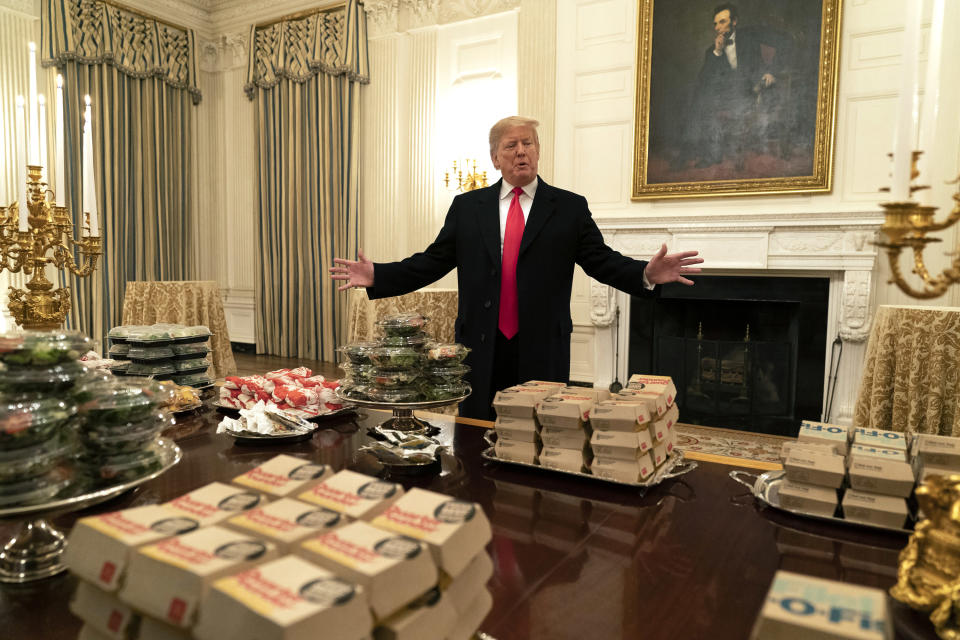 President Donald J. Trump presents fast food to be served to the Clemson Tigers football team to celebrate their Championship at the White House. (Chris Kleponis / Polaris)