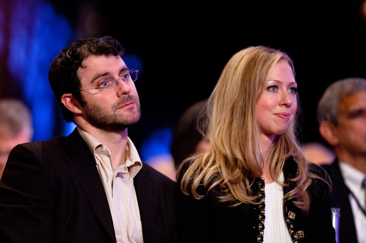 NEW YORK CITY- SEPTEMBER 22: Daughter of former US President Bill Clinton Chelsea Clinton (R) sits with her husband Marc Mezvinsky during the closing Plenary session of the seventh Annual Meeting of the Clinton Global Initiative (CGI) at the Sheraton New York Hotel on September 22, 2011 in New York City. Established in 2005 by former U.S. President Bill Clinton, the CGI assembles global leaders to develop and implement solutions to some of the world's most urgent problems. (Photo by Daniel Berehulak/Getty Images)