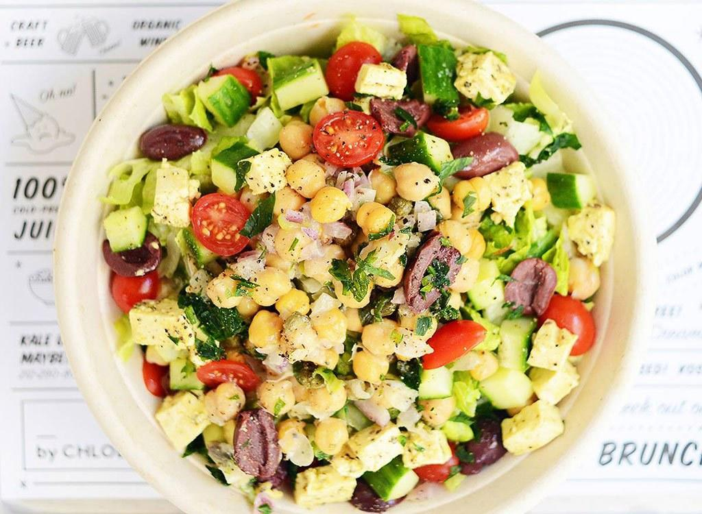 """""""The Greek salad packs a large dose of immune-boosting vitamin C and antioxidants from the tomato and basil,"""" Beckerman says. Even though the standard order is pretty healthy, you can make a few simple changes to improve the nutrition. """"In order to take it to the next nutritional level, ask for kale as the base instead of Romaine. You can pack in more fiber and phytonutrients with kale to help you stay healthy and strong,"""" Beckerman adds.  She also says the chickpeas are excellent sources of complex carbs, so you stay full long after you eat this meal. """"Add a side of avocado to keep you even fuller longer all while reaping the nutritional benefits of potassium, which helps you maintain a healthy blood pressure,"""" Beckerman says."""