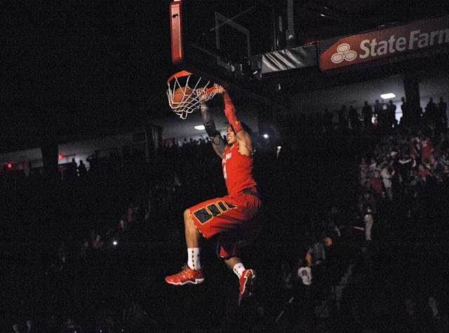 Maryland's Seth Allen dunks during Maryland Madness college basketball events, Friday, Oct. 18, 2013, in College Park, Md. (AP Photo/Nick Wass)