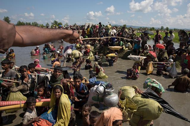 <p>Thousands of Rohingya refugees fleeing from Myanmar are kept under a tight security by Bangladeshi military in hot sun near Palang Khali, Cox's Bazar, Bangladesh, on October 16, 2017. (Photograph by Paula Bronstein/Getty Images) </p>
