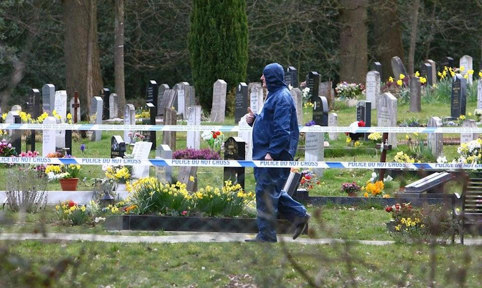 A forensics officer in Haywards Heath Cemetery in West Sussex in 2009 when the body of an unidentified man exhumed by Sussex Police (Gareth Fuller/PA) (PA Archive)