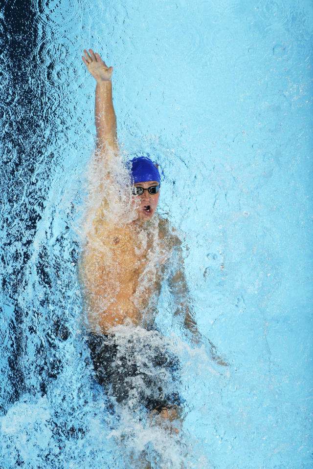 Ryan Lochte swims in the men's 400-meter individual medley final at the U.S. Olympic swimming trials, Monday, June 25, 2012, in Omaha, Neb. (AP Photo/Mark Humphrey)