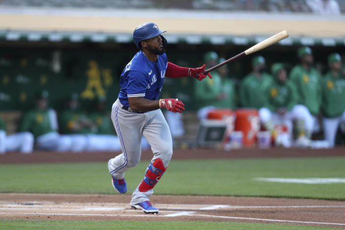 Toronto Blue Jays' Teoscar Hernandez watches his RBI single against the Oakland Athletics during the first inning of a baseball game in Oakland, Calif., Wednesday, May 5, 2021. (AP Photo/Jed Jacobsohn)
