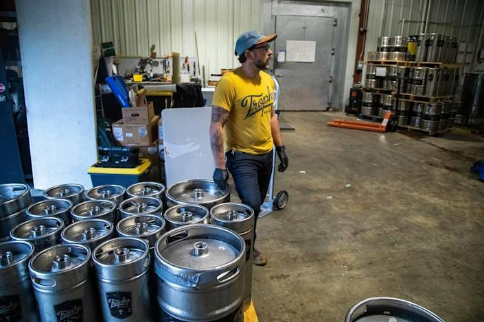 Chief Brewing Officer Les Stewart supervises operations at Trophy Brewing Company's Maywood Avenue location in Raleigh Tuesday, May 19, 2020. Trophy started kegging more beers and brewing limited small batches in anticipation of selling to more restaurants as coronavirus restrictions are lifted. Stewart says they are taking a more cautious wait-and-see approach with the dine-in side of the business.