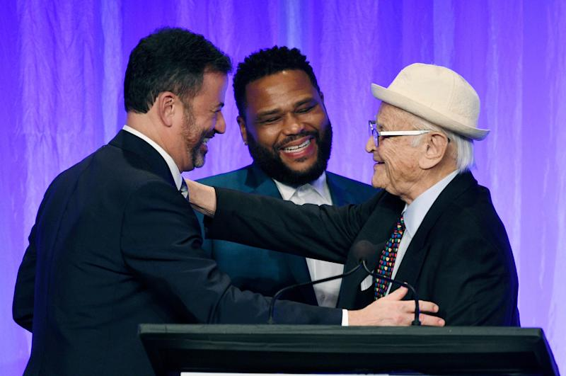 All-time producing great Norman Lear, right, embraces ABC late-night host Jimmy Kimmel, left, and 'Black-ish' star Anthony Anderson during a Paley Honors tribute to TV comedy legends.