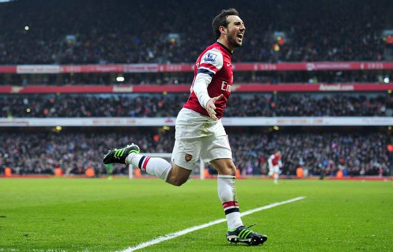 Arsenal's midfielder Santi Cazorla celebrates scoring against Aston Villa in London on February 23, 2013