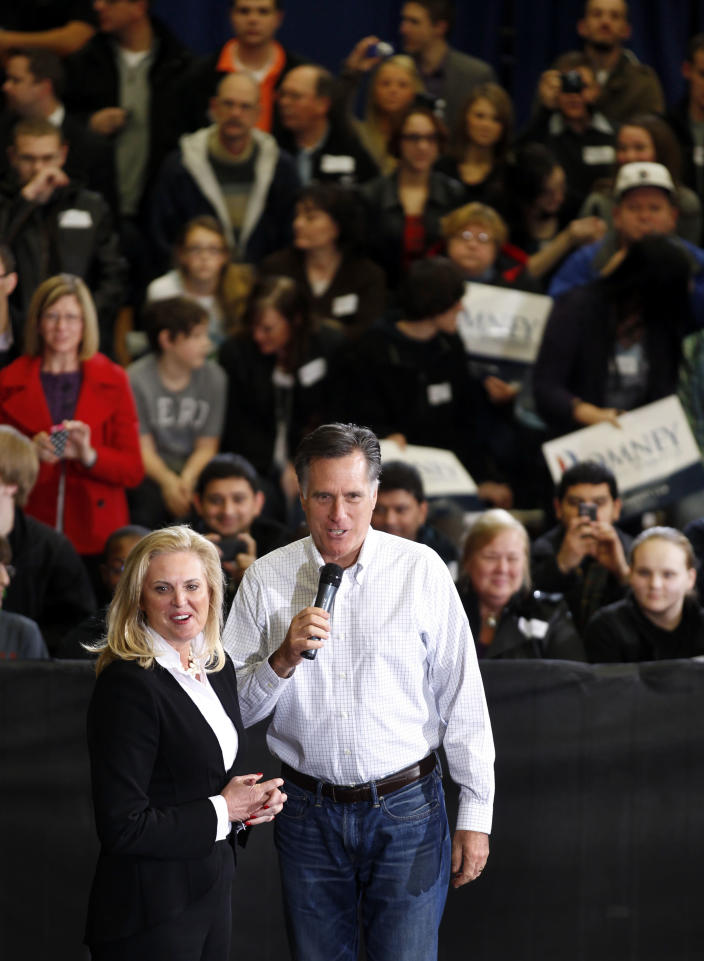 Republican presidential candidate, former Massachusetts Gov. Mitt Romney and his wife Ann speak at a campaign rally in Flint, Mich., Saturday, Feb. 25, 2012. (AP Photo/Gerald Herbert)