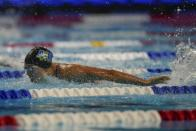 Torri Huske participates in the Women's 100 Butterfly during wave 2 of the U.S. Olympic Swim Trials on Monday, June 14, 2021, in Omaha, Neb. (AP Photo/Jeff Roberson)