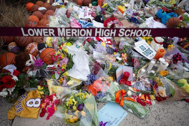 PHOTO: Basketballs, flowers, letters, and jerseys are left at a memorial for former Los Angeles Laker Kobe Bryant in this Jan. 27, 2020 photo, at Lower Merion High School in Ardmore, Pa., after Bryant, a former student, was killed in a helicopter crash. (Mitchell Leff/Getty Images)