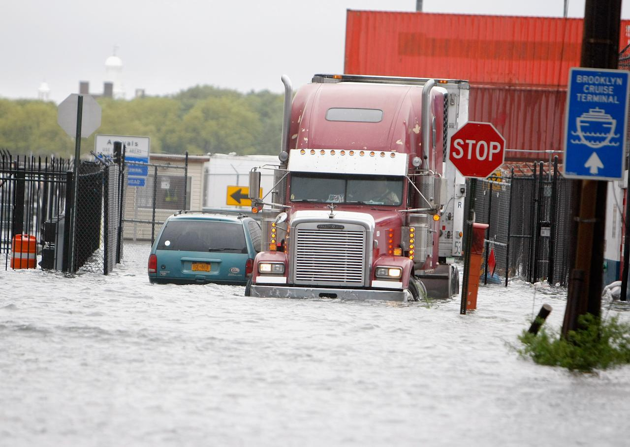 NEW YORK, NY - AUGUST 28:  A tractor trailor pushes through flood waters outside of the Brooklyn Cruise Terminal in Red Hook in the aftermath of Hurricane Irene on August 28, 2011 in the Brooklyn borough of New York City.  The hurricane hit New York as a Category 1 storm before being downgraded to a tropical storm.  (Photo by Jemal Countess/Getty Images)