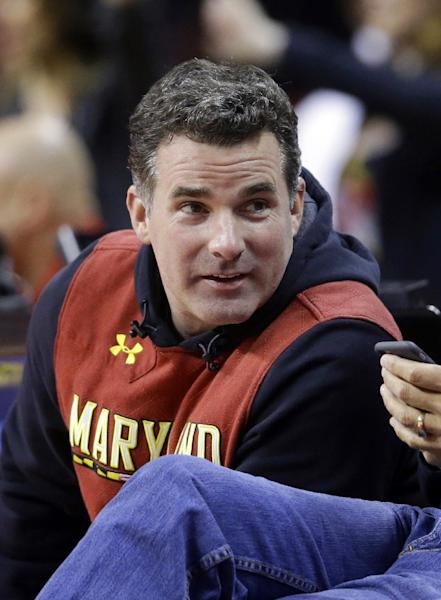 "In this Saturday, Jan. 17, 2015 photo, Under Armour founder Kevin Plank sits courtside during the second half of an NCAA college basketball game between Maryland and Michigan State, in College Park, Md. Plank, is responding to criticism he received after calling President Donald Trump ""an asset to the country."" Plank wrote an open letter to Baltimore published as a full-page advertisement in The Baltimore Sun Wednesday, Feb. 15, 2017. (AP Photo/Patrick Semansky)"