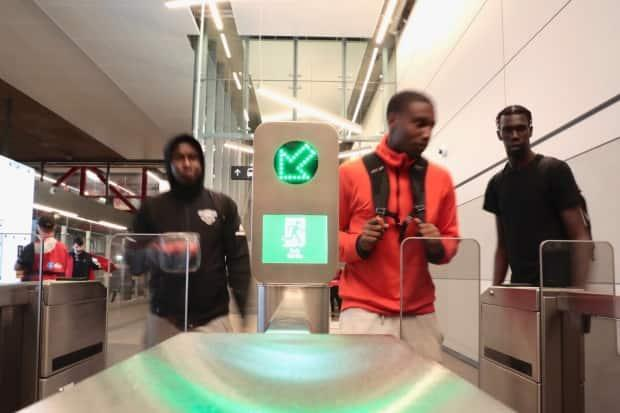 Riders entering one fare gate at the western end of Rideau station can now pay by tapping a credit card, phone or watch.
