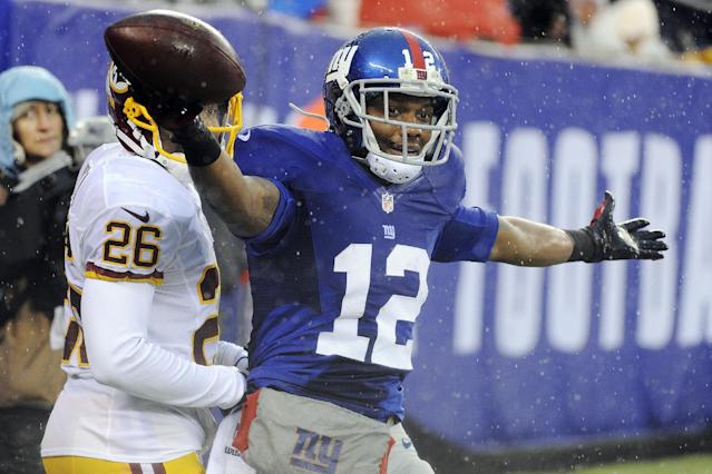 New York Giants wide receiver Jerrel Jernigan (12) celebrates a touchdown reception during the first half of an NFL football game against the Washington Redskins, Sunday, Dec. 29, 2013, in East Rutherford, N.J. (AP Photo/Bill Kostroun)