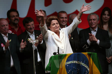 Brazil's President and Workers' Party (PT) presidential candidate Dilma Rousseff celebrates during a news conference after disclosure of the election results, in Brasilia October 26, 2014. REUTERS/Ueslei Marcelino