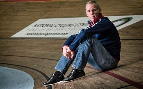 <span>Sutton pictured on the boards of the Manchester Velodrome, the home of British Cycling </span> <span>Credit: PAUL COOPER </span>