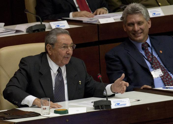 Cuba's new Vice-President Miguel Diaz-Canel, right, listens to Cuba's President Raul Castro during the closing session at the National Assembly in Havana, Cuba, Sunday, Feb. 24, 2012. Raul Castro accepted a new five-year term that will be, he said, his last as Cuba's president and tapped rising star Miguel Diaz-Canel, 52, as vice-president and first in the line of succession. Diaz-Canel has risen higher than any other Cuban official who didn't directly participate in the 1959 Cuban revolution. At center Cuba's Minister of Foreign Affairs Bruno Rodriguez.(AP Photo/Ramon Espinosa)
