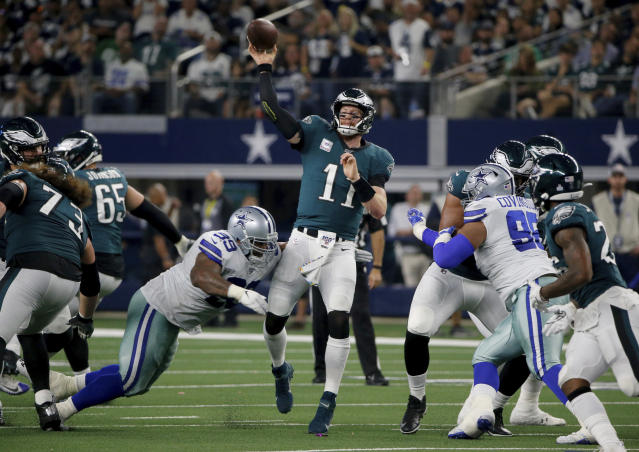 Dallas Cowboys defensive tackle Antwaun Woods (99) pressures Philadelphia Eagles' Carson Wentz (11) on a pass attempt in the first half of an NFL football game in Arlington, Texas, Sunday, Oct. 20, 2019. (AP Photo/Michael Ainsworth)
