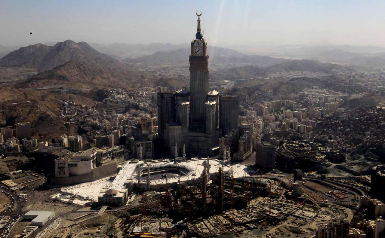 The Abraj Al Bait Towers in Mecca, Saudi Arabia, commonly referred to as the Mecca Royal Hotel Clock Tower. Its clock is visible from 17 kilometres away in the middle of the night and is six times bigger than London's Big Ben.