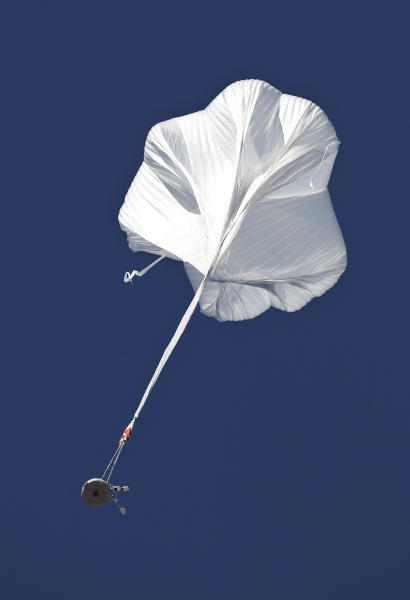 The capsule and attached helium balloon carrying Felix Baumgartner lifts off as he attempts to break the speed of sound with his own body by jumping from a space capsule lifted by a helium balloon, Sunday, Oct. 14, 2012, in Roswell, N.M. Baumgartner plans to jump from an altitude of 120,000 feet, an altitude chosen to enable him to achieve Mach 1 in free fall, which would deliver scientific data to the aerospace community about human survival from high altitudes.(AP Photo/Ross D. Franklin)