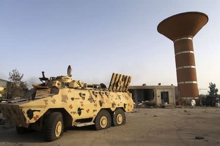 An armoured vehicle is seen after fighting between Libyan special forces and ex-rebel fighters of the Benghazi Shura Council in Benghazi