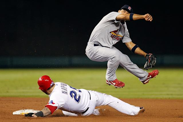 ARLINGTON, TX - OCTOBER 23: Rafael Furcal #15 of the St. Louis Cardinals turns the double play as Mike Napoli #25 of the Texas Rangers slides into second base in the eighth inning during Game Four of the MLB World Series at Rangers Ballpark in Arlington on October 23, 2011 in Arlington, Texas. (Photo by Tom Pennington/Getty Images)