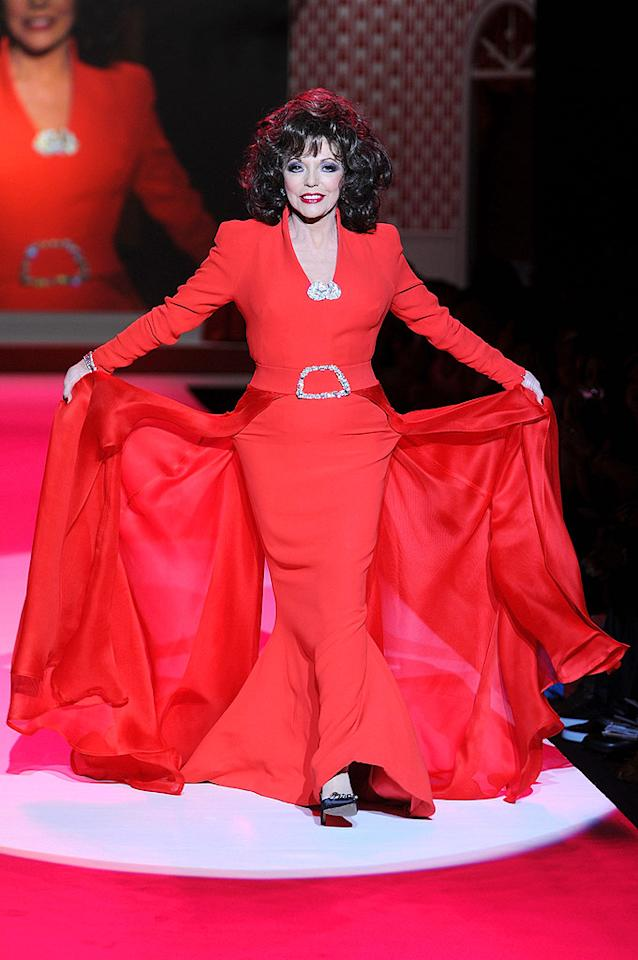 "Joan Collins channeled her ""Dynasty"" character Alexis Carrington Colby with her big hair and dramatic flowing gown. Frazer Harrison/<a href=""http://www.gettyimages.com/"" target=""new"">GettyImages.com</a> - February 11, 2010"