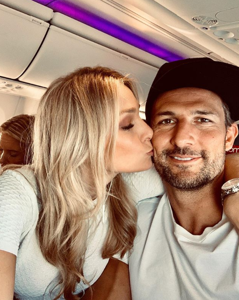 A photo of Tim Robards and Anna Heinrich on a plane.