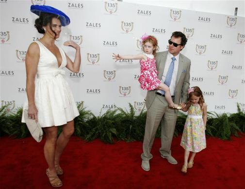 Actress Brooke Shields arrives for the the Kentucky Derby with her husband Chris Henchy and daughters Grier (L) and Rowan at Churchill Downs, May 2, 2009.