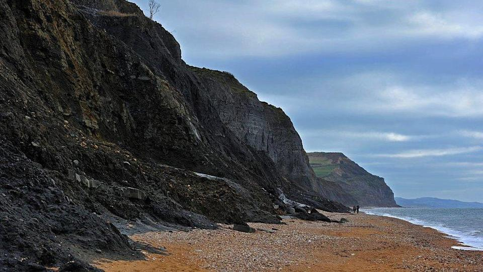 Black Ven landslide on beach between Lyme Regis and Charmouth along the Jurassic Coast