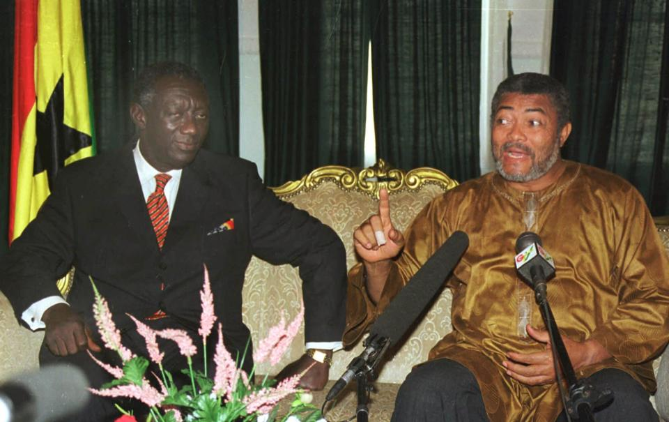 FILE - In this Jan. 3, 2001 file photo, outgoing President Jerry Rawlings of Ghana, right, meets with President-elect John Kufuor, left, as they hold discussions on the transfer of power in Accra, Ghana. Ghana's former president Jerry Rawlings, who staged two coups and later led the West African country's transition to a stable democracy, has died aged 73, according to the state's Radio Ghana and the president Thursday, Nov. 12, 2020. (AP Photo/ Clement Ntaye, File)
