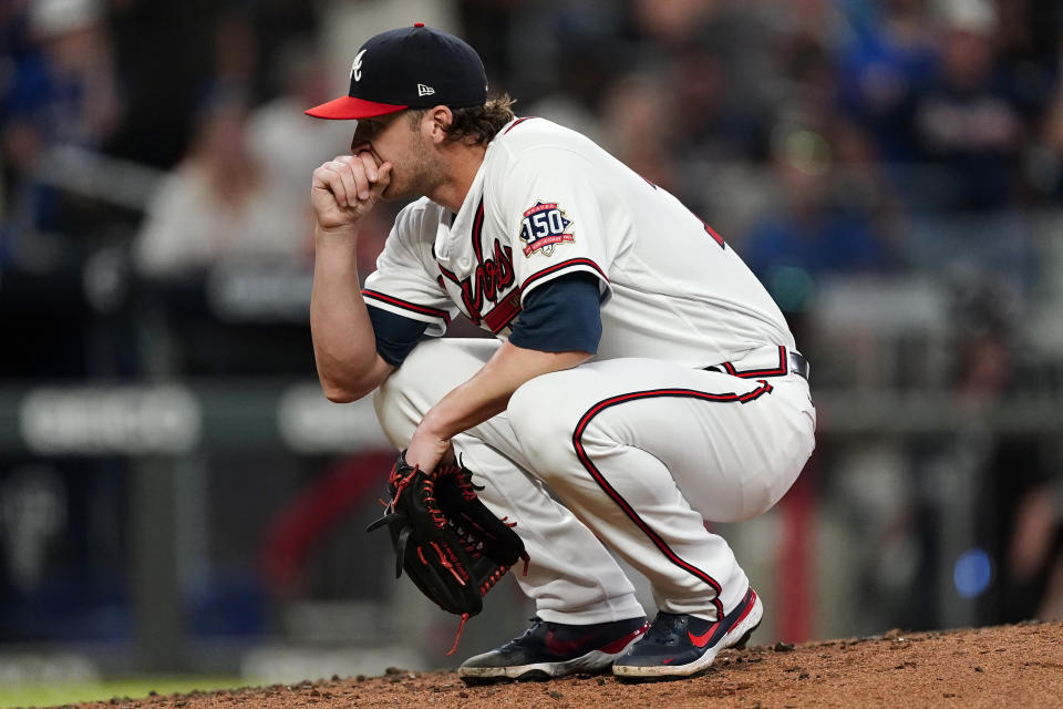 Atlanta Braves relief pitcher Jacob Webb reacts after hitting New York Mets' Kevin Pillar with a pitch in the seventh inning of a baseball game Monday, May 17, 2021, in Atlanta. (AP Photo/John Bazemore)