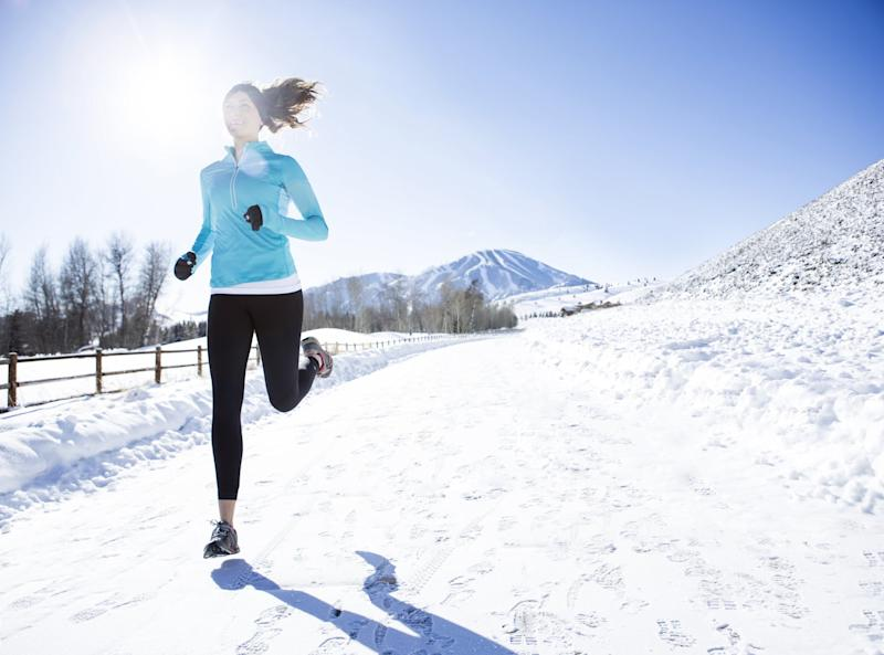 A woman jogging in Sun Valley on a beautiful winter day.