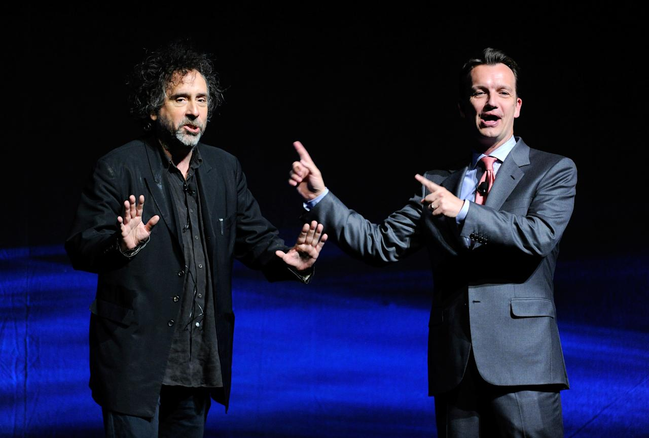"LAS VEGAS, NV - APRIL 24:  Director Tim Burton (L) and President of Walt Disney Studios Motion Picture Production Sean Bailey speak at a Walt Disney Studios Motion Pictures presentation to promote Burton's upcoming film, ""Frankenweenie"" at The Colosseum at Caesars Palace during CinemaCon, the official convention of the National Association of Theatre Owners, April 24, 2012 in Las Vegas, Nevada.  (Photo by Ethan Miller/Getty Images)"