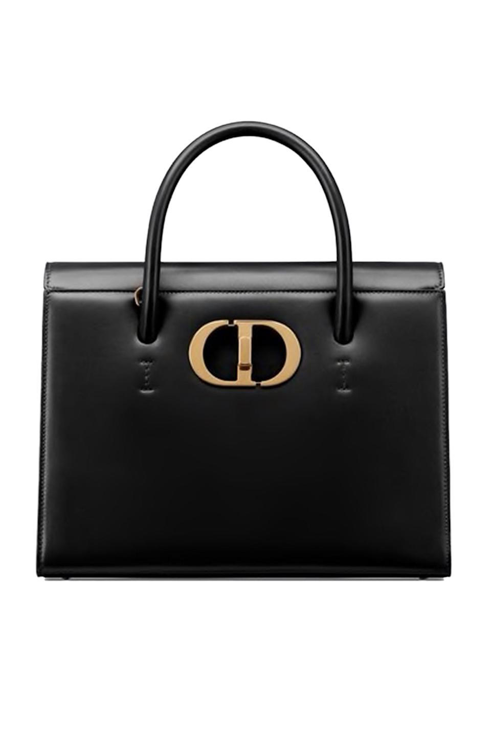 """<p><strong>Dior</strong></p><p>dior.com</p><p><strong>$4600.00</strong></p><p><a href=""""https://go.redirectingat.com?id=74968X1596630&url=https%3A%2F%2Fwww.dior.com%2Fen_us%2Fproducts%2Fcouture-M9306UMOS_M911-large-st-honore-tote-black-box-calfskin%3FobjectID%3DM9306UMOS_M911%26query%3DST%2BHONOR%25C3%2589%26queryID%3D75be32bedeb2433aa11e3ba242ee9378&sref=https%3A%2F%2Fwww.elle.com%2Ffashion%2Fshopping%2Fg34551759%2Ffall-investment-bags-2020%2F"""" rel=""""nofollow noopener"""" target=""""_blank"""" data-ylk=""""slk:Shop Now"""" class=""""link rapid-noclick-resp"""">Shop Now</a></p><p>Dior did not come to play with its newest bag, the St. Honoré. It's business in the front, and downtown party in the back, with '30 Montaigne' embossed on the posterior. </p>"""