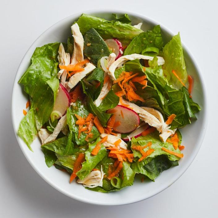 """<p>Keeping cooked chicken and prepared sesame-ginger dressing on hand means this healthy lunch salad comes together in a snap. <a href=""""https://www.eatingwell.com/recipe/262761/sesame-ginger-chicken-salad/"""" rel=""""nofollow noopener"""" target=""""_blank"""" data-ylk=""""slk:View Recipe"""" class=""""link rapid-noclick-resp"""">View Recipe</a></p>"""