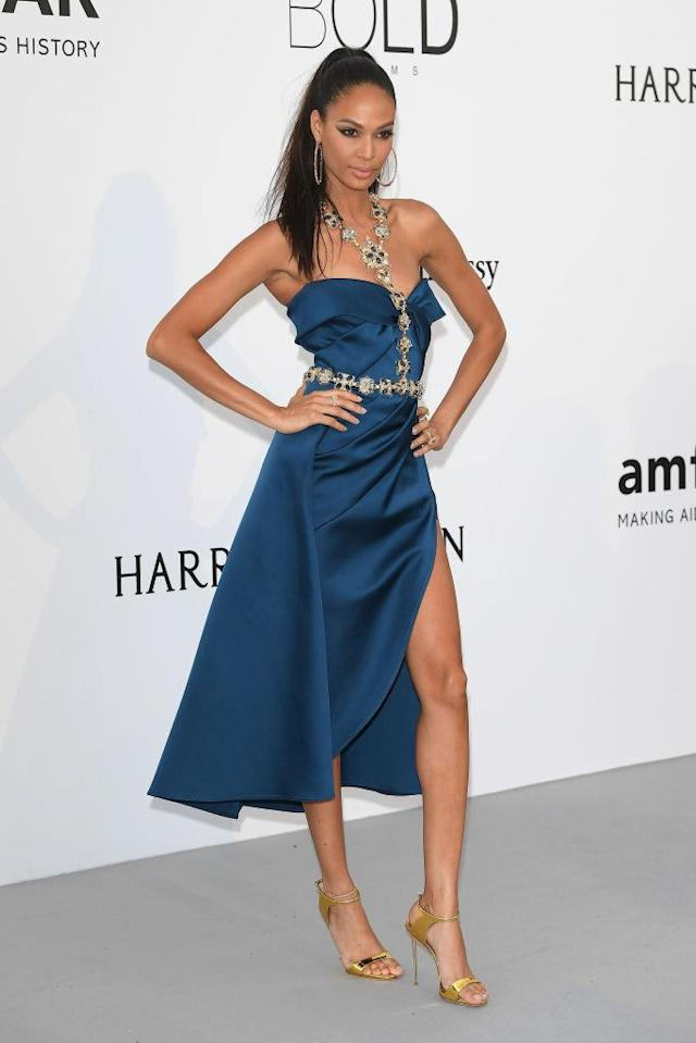<p>The model wore a design from Elie Saab's Haute Couture spring summer 2017 collection at the amfAR gala. (Photo by Venturelli/WireImage for amfAR) </p>