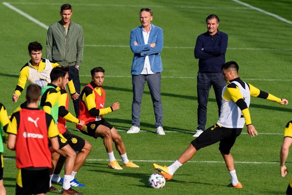 Borussia Dortmund CEO Hans-Joachim Watzke (centre), sporting director Michael Zorc (right) and head of the player licensing department Sebastian Kehl watch a training session in September 2020.