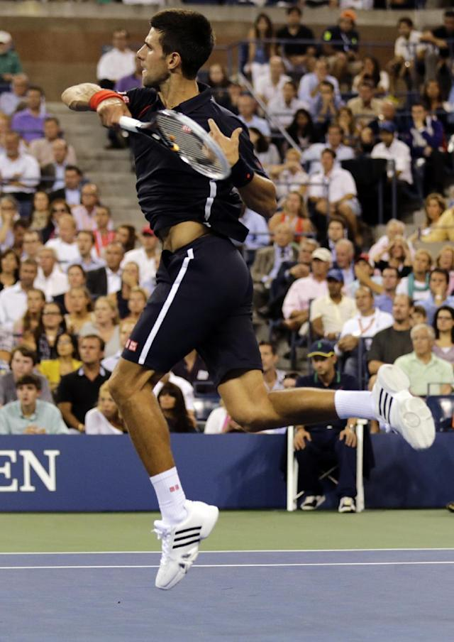 Novak Djokovic, of Serbia, returns to Juan Martin del Potro, of Argentina, in the quarterfinal round of play at the U.S. Open tennis tournament, Thursday, Sept. 6, 2012, in New York. (AP Photo/Charles Krupa)