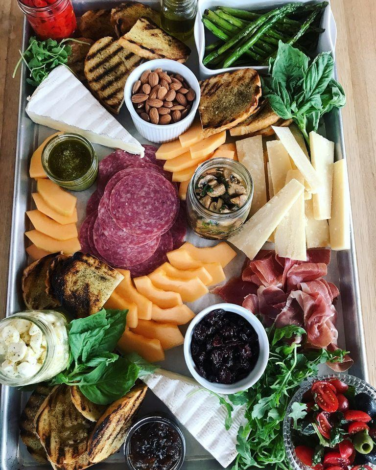 """<p>Fill a big board with cheeses, meats, crackers, and more. It can be as simple or as complicated as you want. </p><p><a href=""""https://www.thepioneerwoman.com/food-cooking/a94970/nice-partay-idea/"""" rel=""""nofollow noopener"""" target=""""_blank"""" data-ylk=""""slk:Get Ree's recipe."""" class=""""link rapid-noclick-resp""""><strong>Get Ree's recipe.</strong></a></p>"""